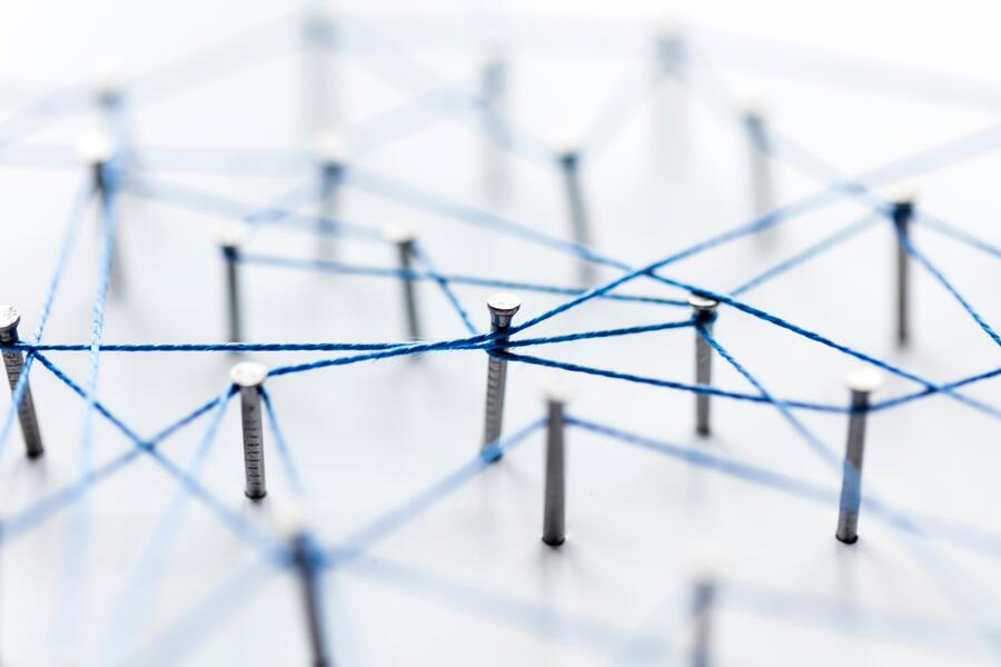 a-large-grid-of-pins-connected-with-string-communication-technology-network-concept_t20_V7nnE8