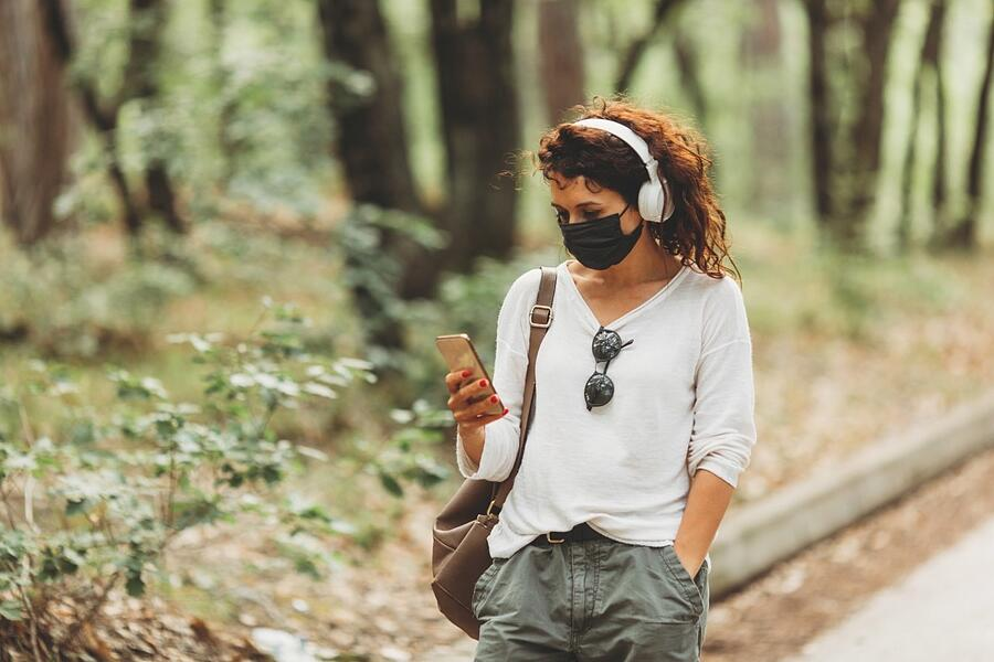 beautiful-young-women-with-phone-walking-in-park-or-forest-in-black-mask_t20_gLz7zk (1)