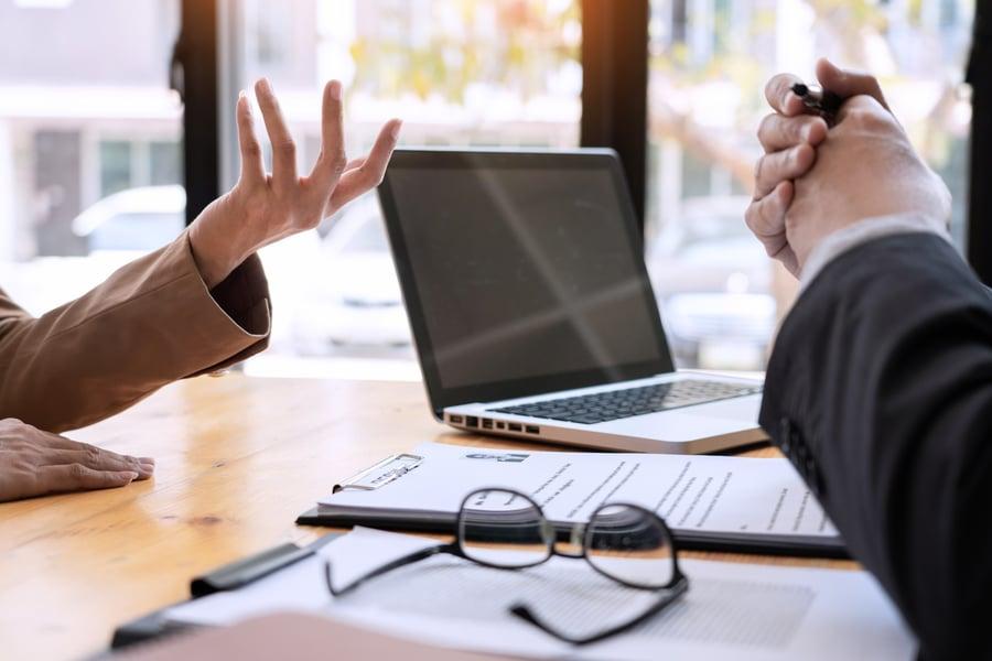 businessman-businesswoman-computer-talking