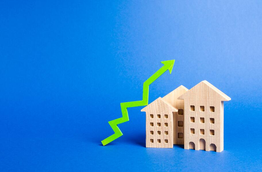 figures-of-residential-buildings-and-green-arrow-up-growth-in-demand-and-liquidity-for-real-estate_t20_gR7Q7k