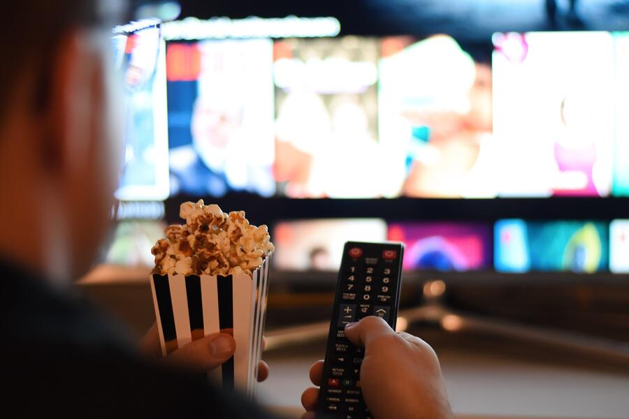 movie-night-watching-tv-television-popcorn-netflix-and-chill-remote-control-hands-holding-at-home_t20_rLlaag